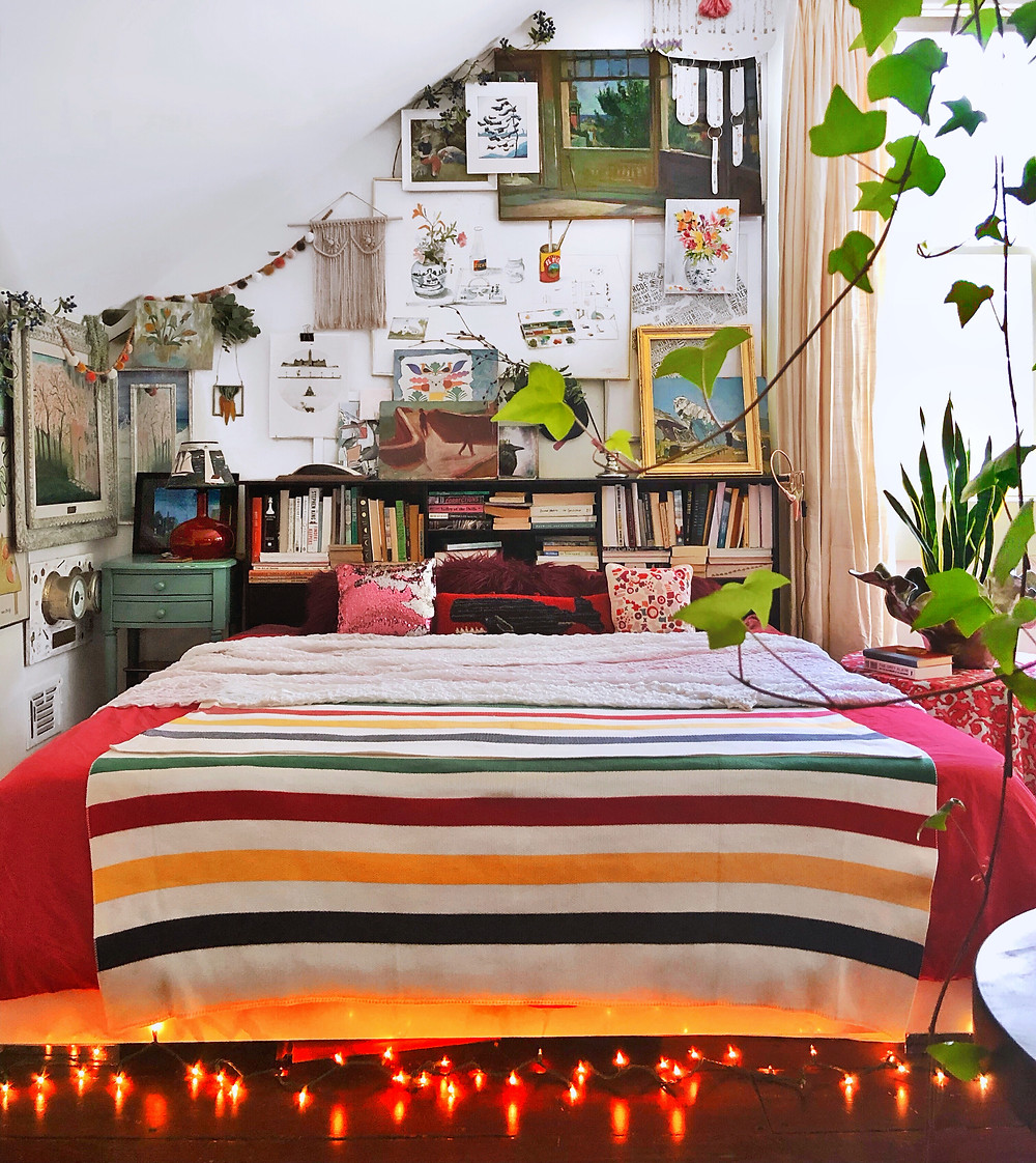 Winter bedding, Hudson Bay blanket, gallery wall on angled wall, twinkly lights under bed
