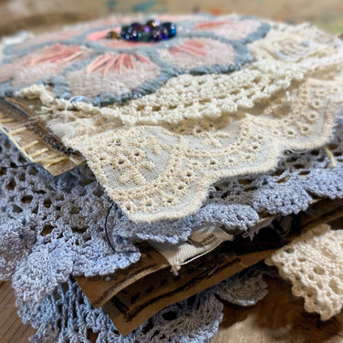 painted and stitched fabric and paper art journal