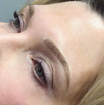 Fluffy dark blonde microblading brows