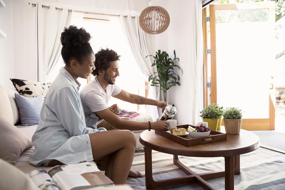 couple in hotel room having breakfast and tea