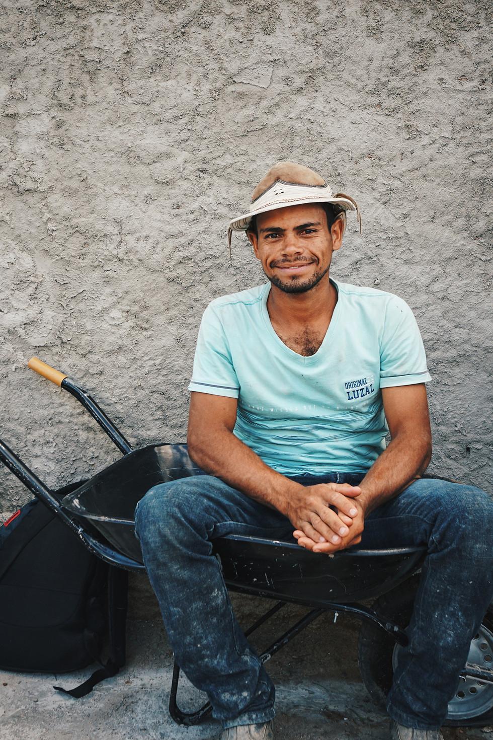 Mason sitting in wheelbarrow