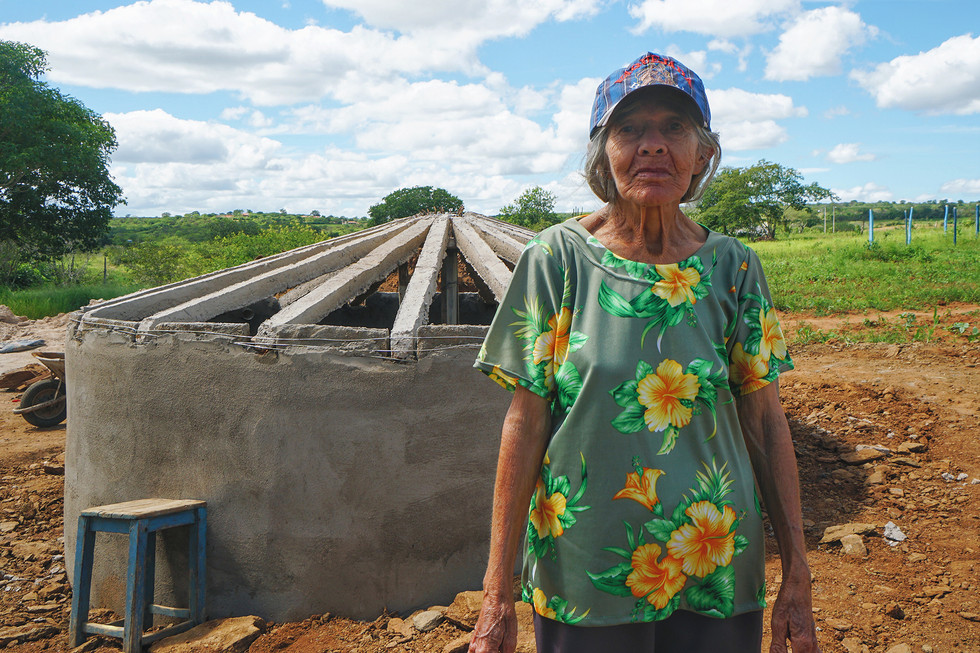 Woman in front of new water cistern