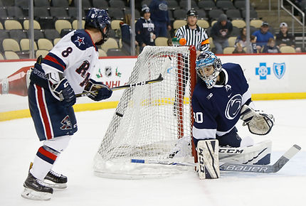 Matthew Erlichman playing ice hockey goalie vs Robert Morris University
