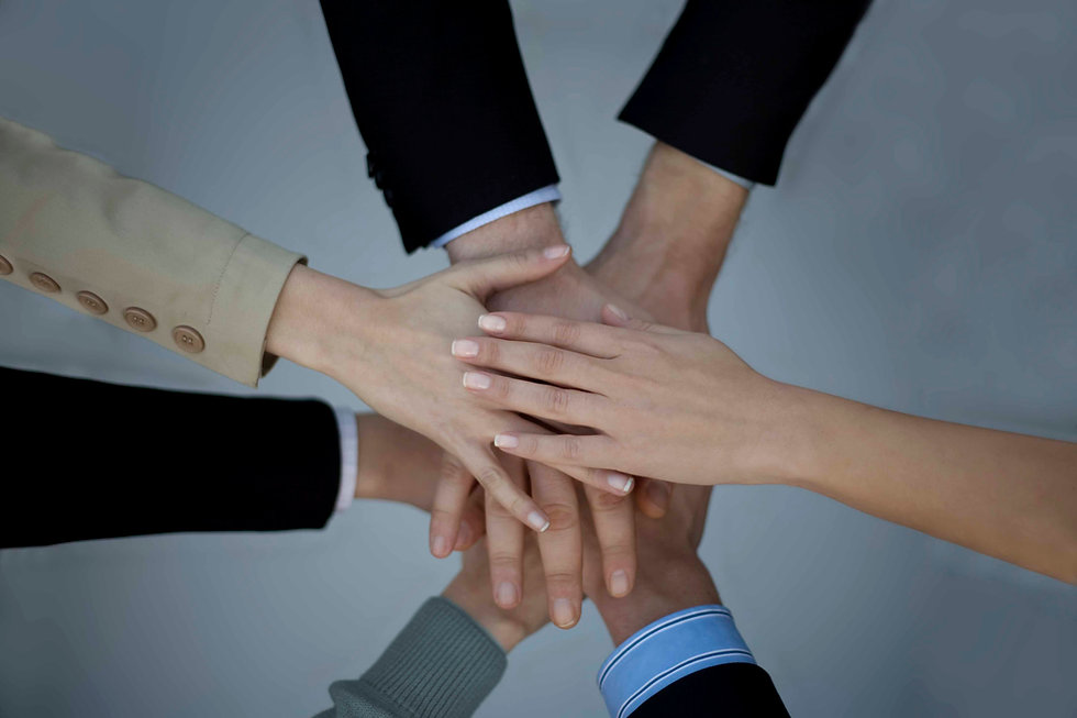 Hands of team members on top of each other