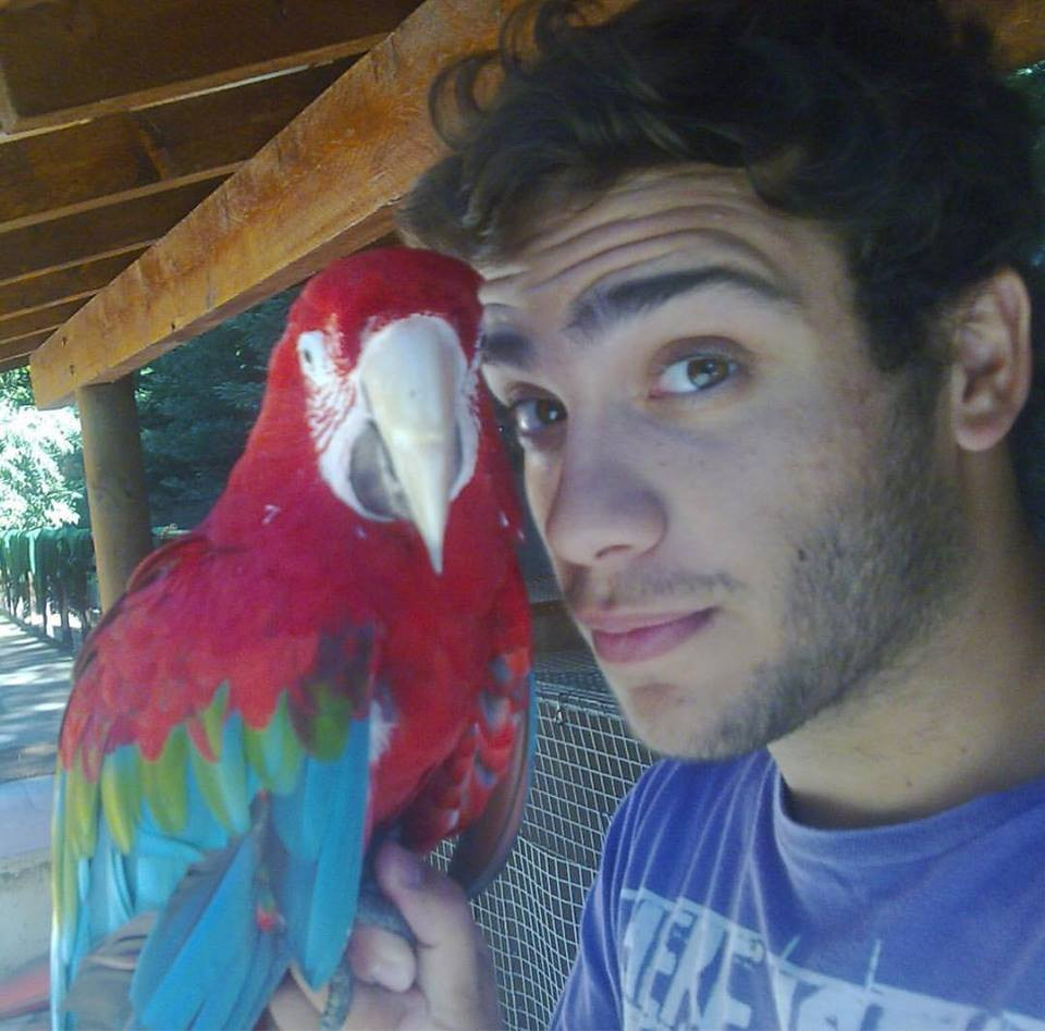Ricardo with a green-winged macaw at Lisbon Zoo, 2009.