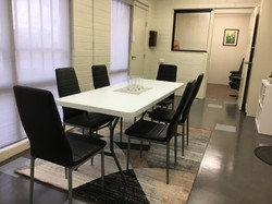 Meeting space for 6 with view of private office