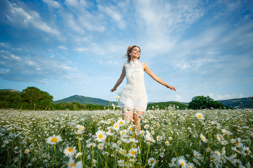 Woman in a field with flowers. Beautiful