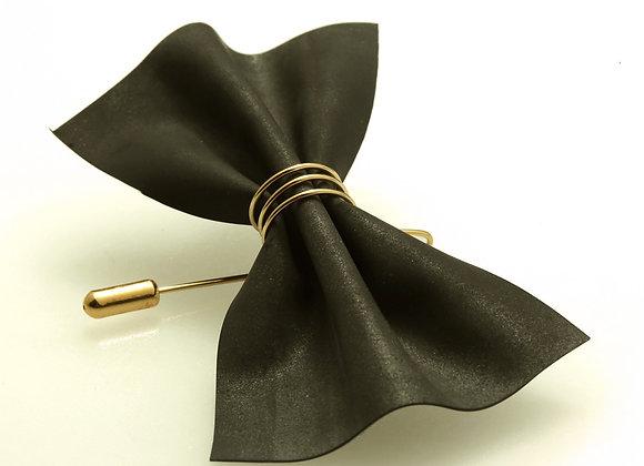 A black bow tie brooch