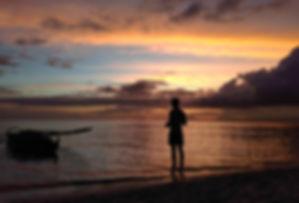 enjoying the sunset at Paliton beach in the philippines