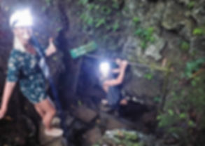 Squeezing throgh the tiny cave entrance o  Siquijor island