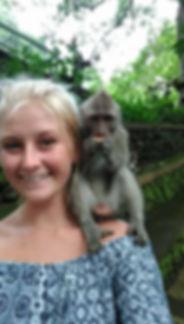 monkey eating on jessie shoulder