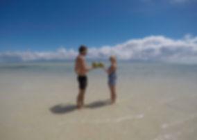 drinking coconuts on the manjuyod sandbar, philippines