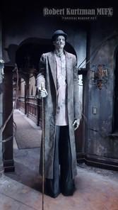 Bowler Hat Man/Tall Man on set