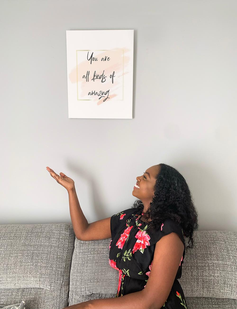 Woman on sofa with wall art