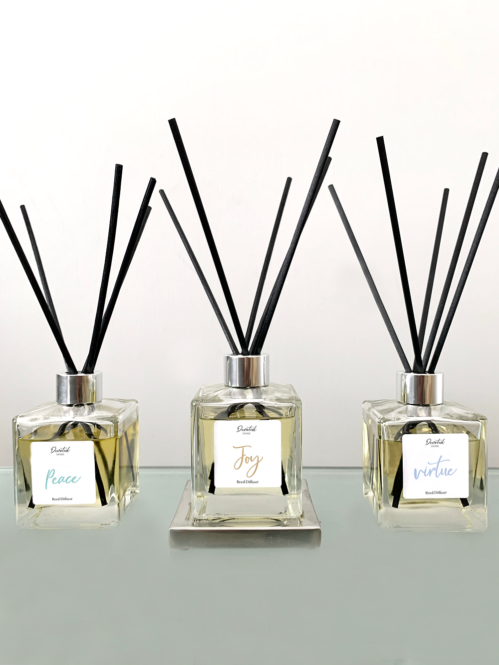 three luxury reed diffusers