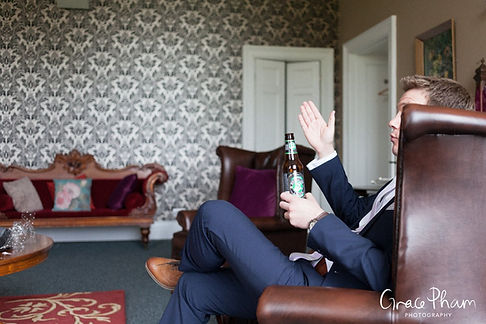 Groom prep photography at Ditton Park Manor