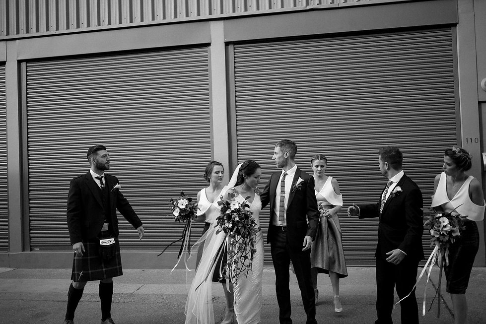 Alternative bridal party in East London streets, warehouse wedding captured by London Wedding Photographer