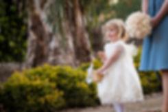 Emu Bottom Homstead wedding, captured by Grace Pham Wedding Photographer. Bridesmaid walking down the path with cute flower girl.