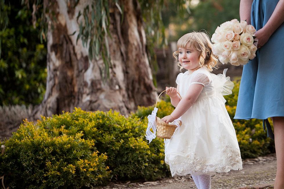 Emu Bottom Homstead wedding, captured by Grace Pham Wedding Photographer. Bridesmaid walking down the path with cute flower girl.