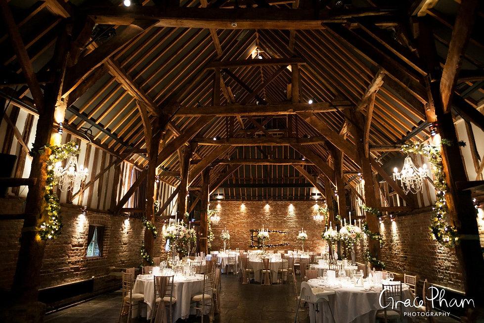 Cooling Castle Wedding Venue, Kent. Reception Room, Tithe Barn captured by Grace Pham Photographer
