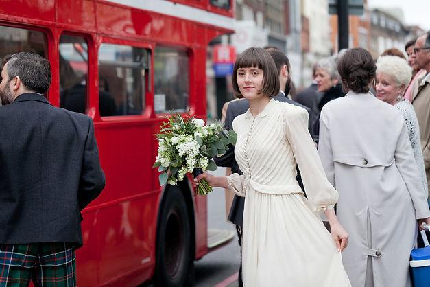 Islington Town Hall Wedding, London red bus moment captured by Grace Pham Wedding Photographer