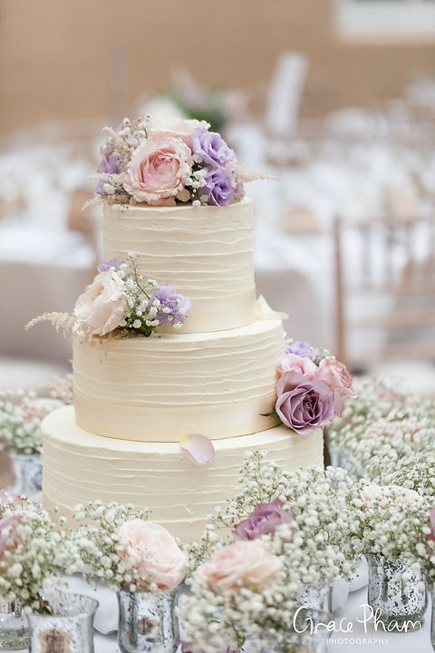 Wedding cake with flowers at Ditton Park Manor
