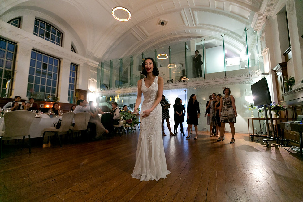 De Monfort Suite Wedding at the Town Hall Hotel. Throwing the bouqet moment.