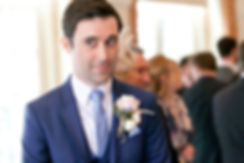 Groom about to see his bride for the first time at Great Fosters, Surrey - Grace Pham  Wedding Photographer