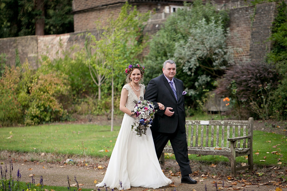 Meaghan Martin's Wedding at Cannizaro House, Wimbledon captured by London Wedding Photographer. Father of the bride walking down with the bride in Cannizaro park 35