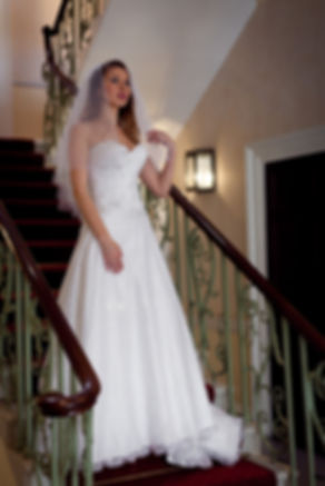 Lace wedding dress, beautiful bride at Merton Register Office, Morden Park House on the staircase.