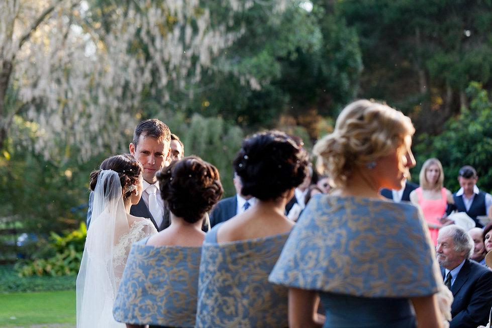 Wedding ceremony at Emu Bottom Homestead. Smitten groom looking at his stunning bride.