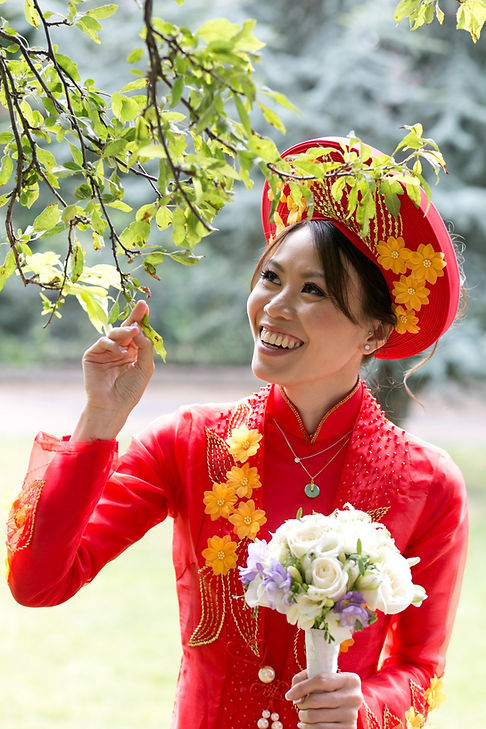Vietnamese Chinese Wedding Photographer, London. Bride wearing Ao Gia, traditional vietnamnese dress.