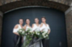 Alternative bridesmaids in East London streets, warehouse wedding captured by London Wedding Photographer