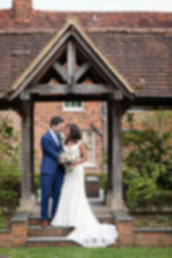 Surrey Wedding Photographer. Image of wedding couple at Great Fosters hotel.