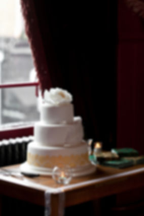 Wedding cake at East Dulwich Tavern captured by Grace Pham Wedding Photographer