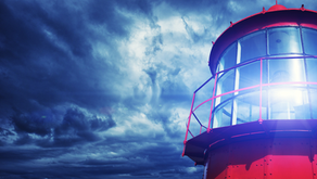 How is a business coach like a lighthouse?