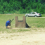 Carl Hirt in Pat McNamara's class shooting from behind cover