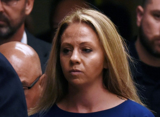 Amber Guyger, charged in the killing of Botham Jean in his own home, arrives on the first day of the