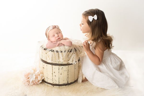 newborn baby with sister