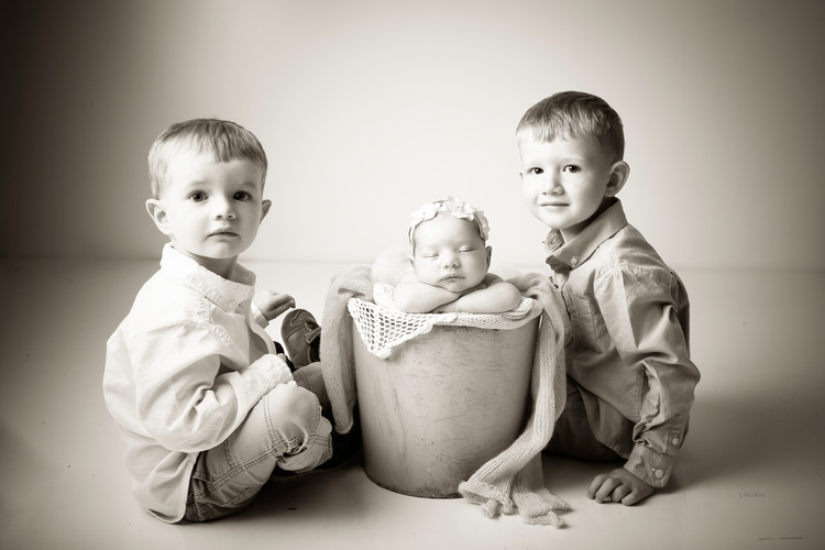 Newborn baby with siblings