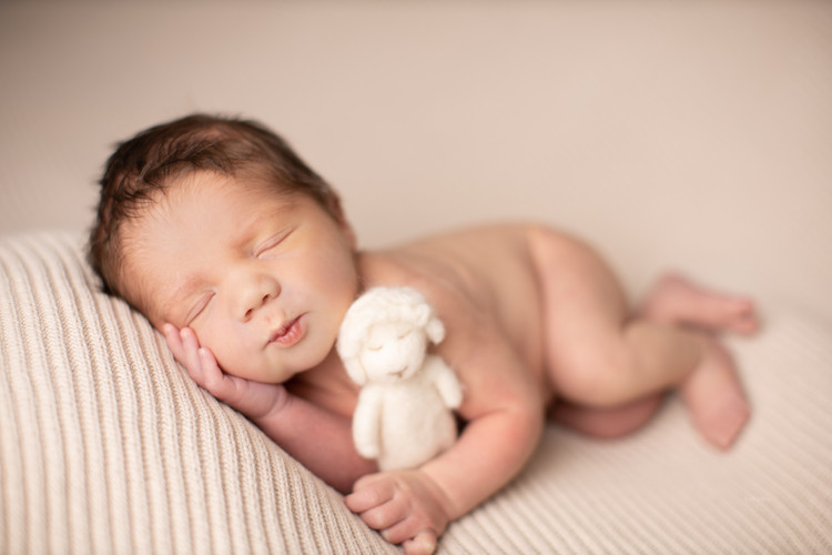 newborn baby boy with toy