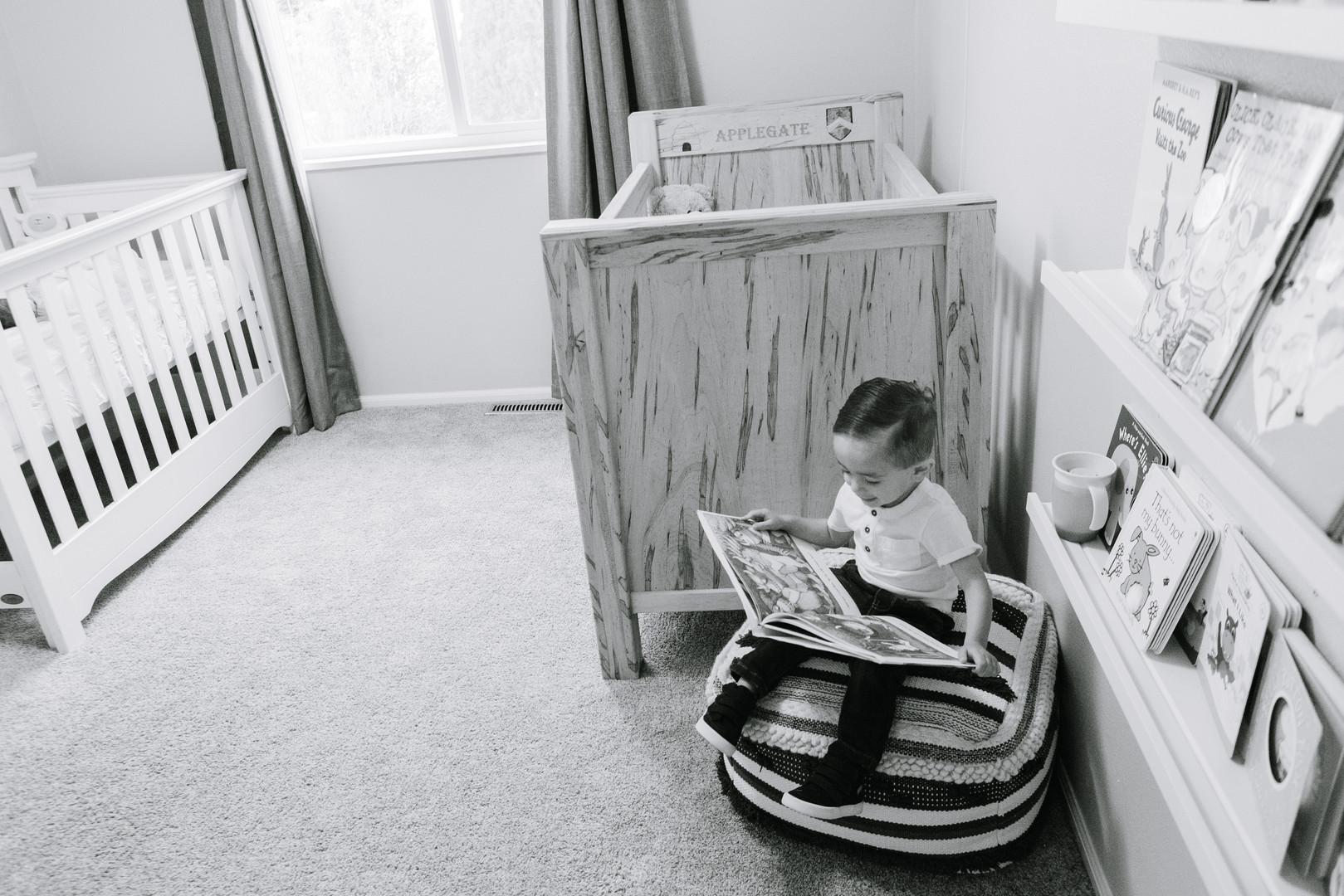 Brother reading to newborn sister