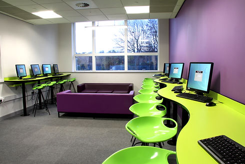College Furniture With Computers And Green Stools