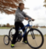 An autism with a Mongoose adult bike training wheels