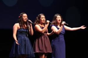 Alumnae Brianna Rancour, Tiffany Cruz, and Anna Osuna paid musical tribute to Isela Sotelo by performing a medley of some of her previous work.