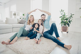 Photo of four people foster family movin