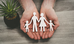 Hands protecting a family; symbol of lif