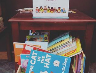 Fill a donation box with reading materials