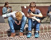 cw - teens boys using cell phones pokemo