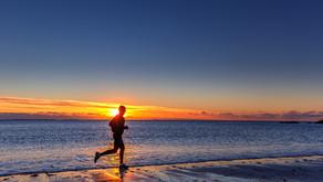 Sunset run on the beach in winter